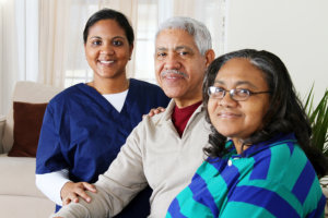 nurse and elderly couple smiling